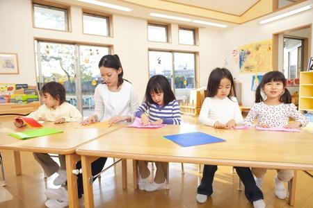 Fold the origami nursery and kindergarten Stock Photo