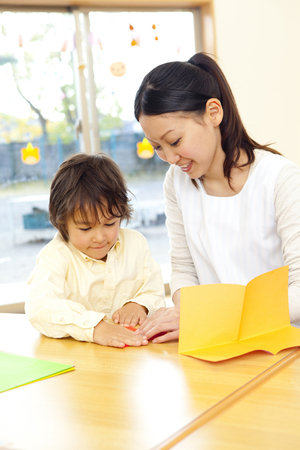 kindy: Fold the origami nursery and nursery garden boys Stock Photo
