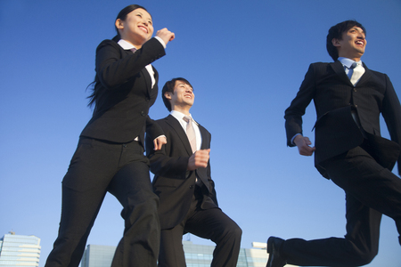feeling happy: Businessmen who run with a smile Stock Photo