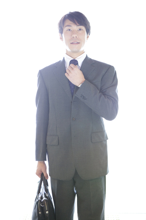 nervousness: Businessman touching the tie Stock Photo