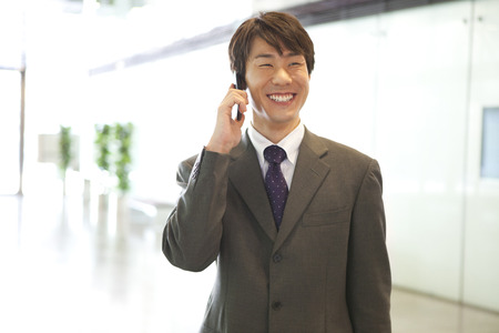 Businessman to call with a smile photo