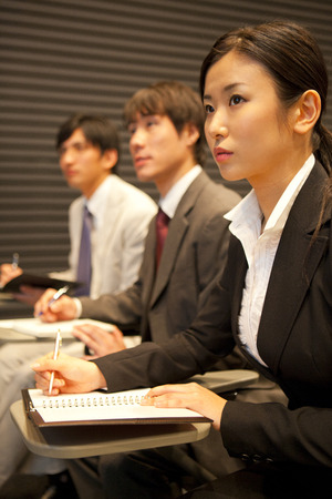 Businessman who is hearing a lecture