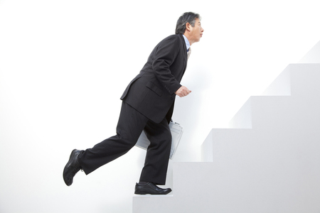 to stumble: Businessman to stumble on the stairs