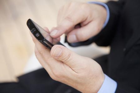 manipulate: Local businessmen to manipulate the Smartphone Stock Photo