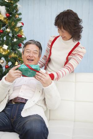 rejoice: Senior men rejoice and senior woman to pass the Christmas gift