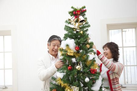 decorate: Senior couple to decorate the tree