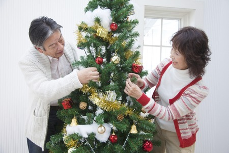 decorate: Senior couple to decorate the tree