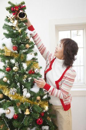 tree decorations: Senior women who decorated the tree Stock Photo