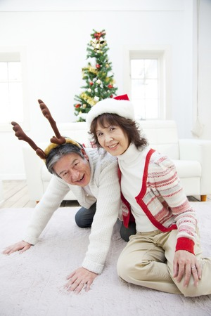 suffered: Senior man who suffered a senior woman and reindeer hat suffered a Santa hat