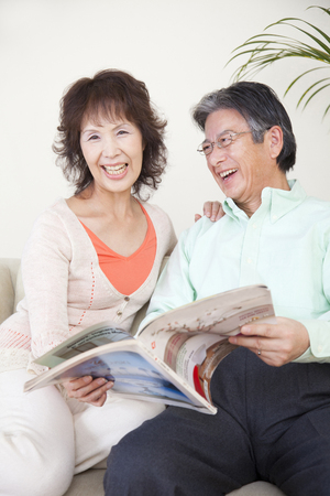 read magazine: Senior couple of smile Read magazine