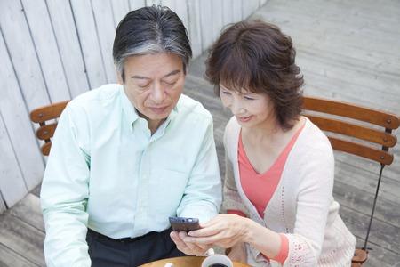 Senior couple touch Smartphone photo