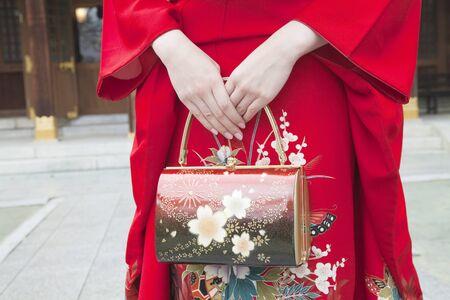 early 20s: Hand woman of kimono wearing
