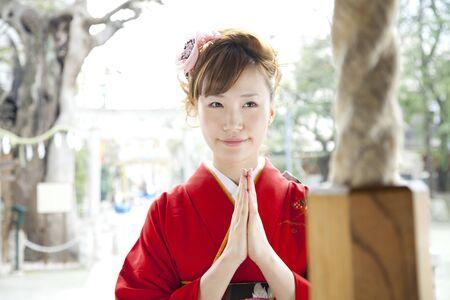 early 20s: Furisode kimono a praying woman