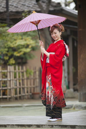 Umbrella smiling furisode kimono woman