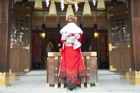 new age: Rear View of female kimono figure to pray