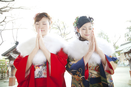 early 20s: Two women praying to furisode kimono