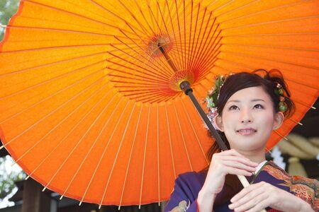 early 20s: Women kimono figure to refer to Japanese umbrella Stock Photo