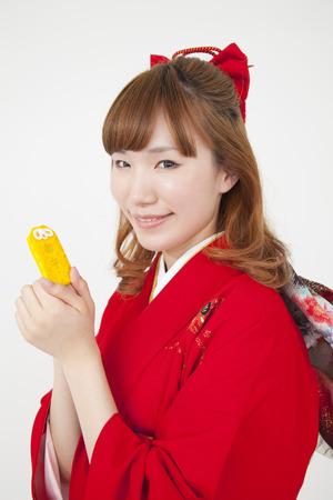 amulet: Women kimono figure with amulet