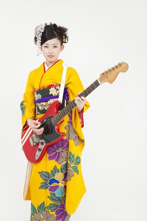 new age music: Women kimono figure with a guitar