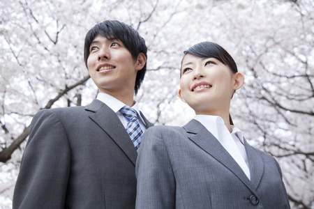 Businessman and OL smiling under the cherry tree