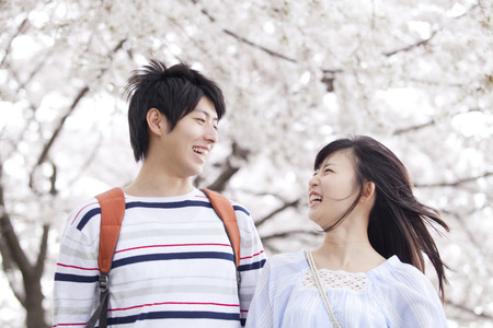 early 20s: Cherry smile walking tree couple