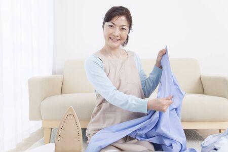 ironing: Housewife ironing Stock Photo