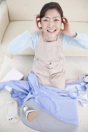 ironing: Housewife tiring to ironing