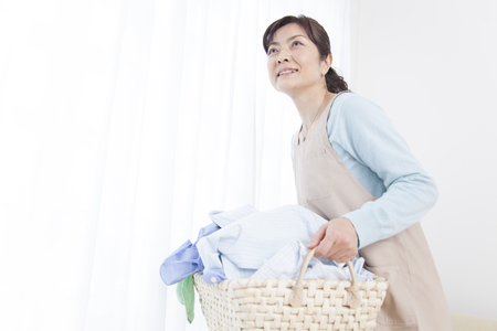 Housewives carrying laundry