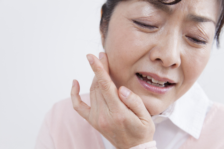 periodontal disease: Middle women tooth decay hurts Stock Photo