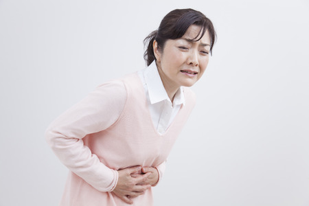 abdominal pain: Middle woman suffering from abdominal pain