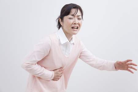 gastroenteritis: Middle woman suffering from abdominal pain