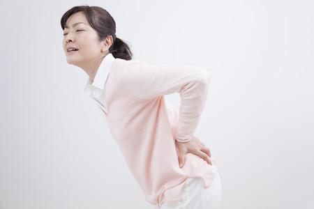 herniated: Middle women waist pain