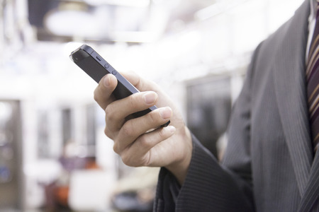 Businessmen to work smart phone on the train