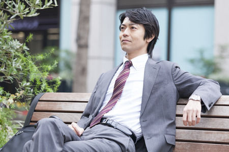 circumference: Businessman to rest on a bench