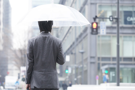 back shot: Back shot of businessman holding an umbrella