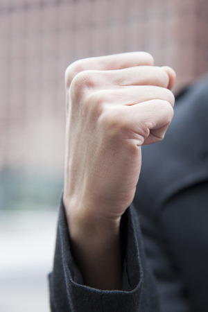 guts: Hand of businessman that the guts pose