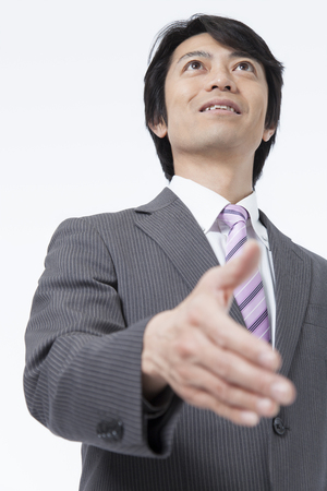 expressed: Businessmen hold out hand Stock Photo