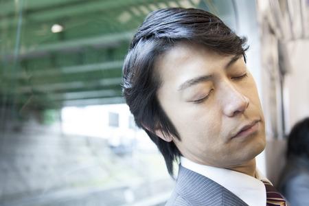 drowse: Businessman sleeping on the train