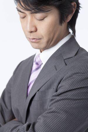 Businessman thoughtfully photo