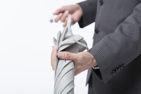 Businessman to fold an umbrella