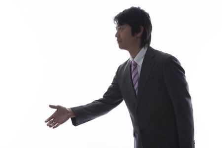 ビジネスマンが手を差し出す 写真素材
