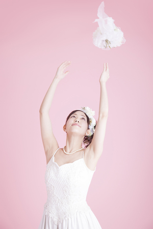 to toss: Bride to the bouquet toss Stock Photo
