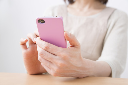 full grown: Housewives to work with Smartphones Stock Photo