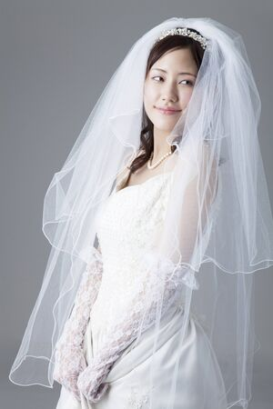 Bride with a hem of the dress Stock Photo