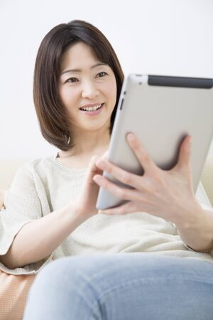 Middle Lady to work with Tablet PC Stock Photo