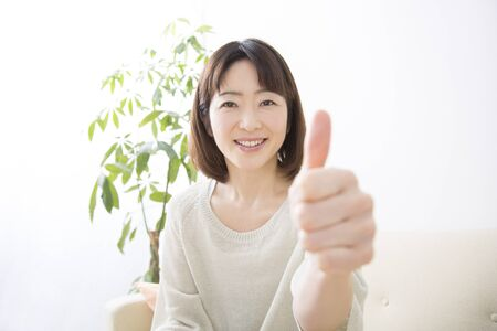 japanese people: Middle women thumbs up