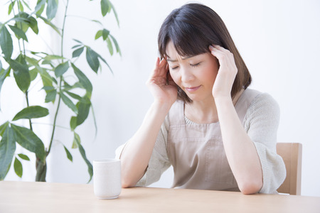 malaise: Housewife suffering from headache Stock Photo