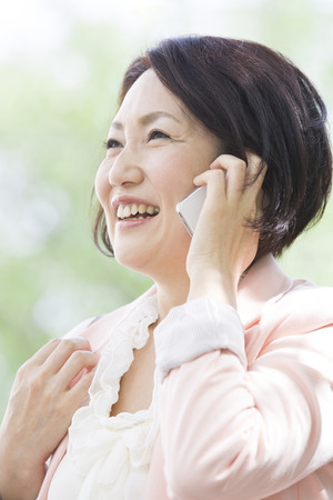 early forties: Middle woman called with a smile
