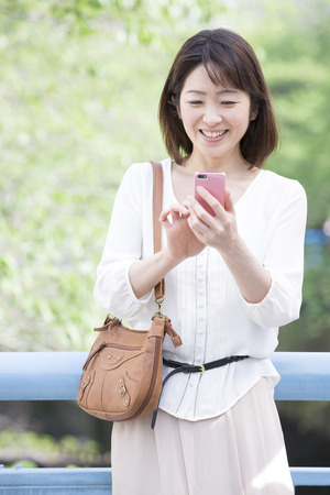 Middle Lady to work with Smartphones photo