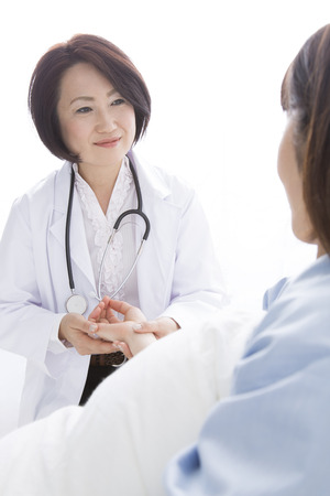 educator: Female doctor and the patient to take the pulse